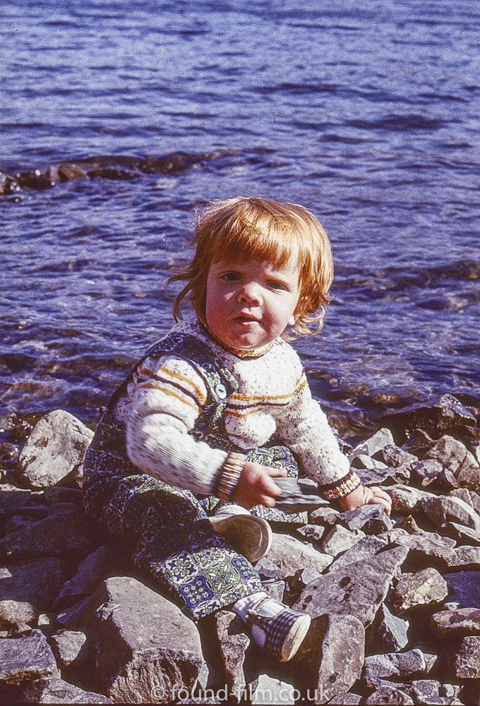 Child by a lake or sea