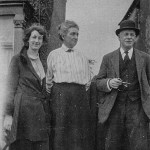 Family group portrait outside a house, mid 1920s