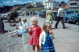 photo of two little girls by seaside during a holiday