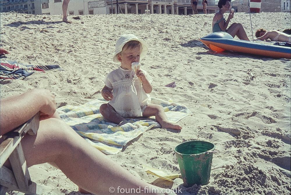 Baby on beach with ice-cream