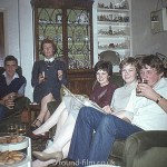 Family sitting on a sofa in a living room