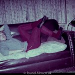 Girl on a sofa in a 1950s interior