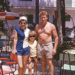 A couple on holiday with their child in July 1966