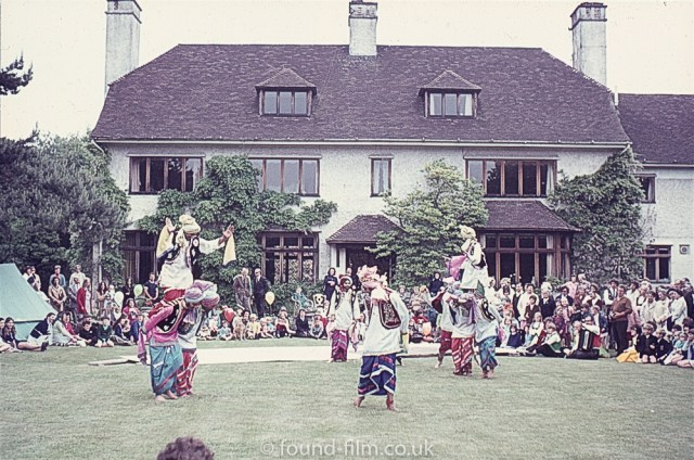 An oriental dance group on a lawn
