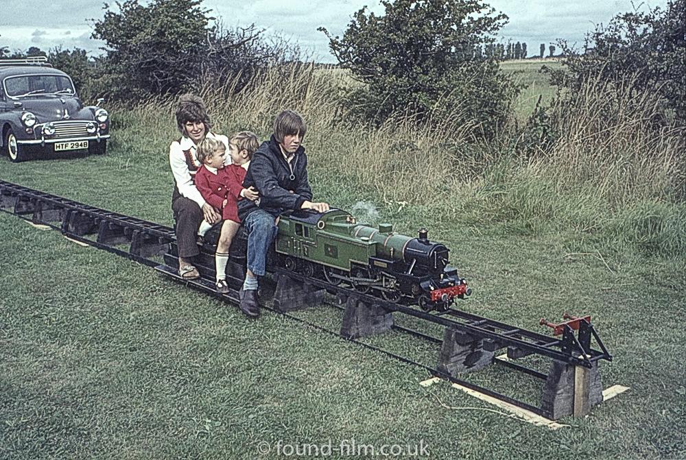 Family on model railway
