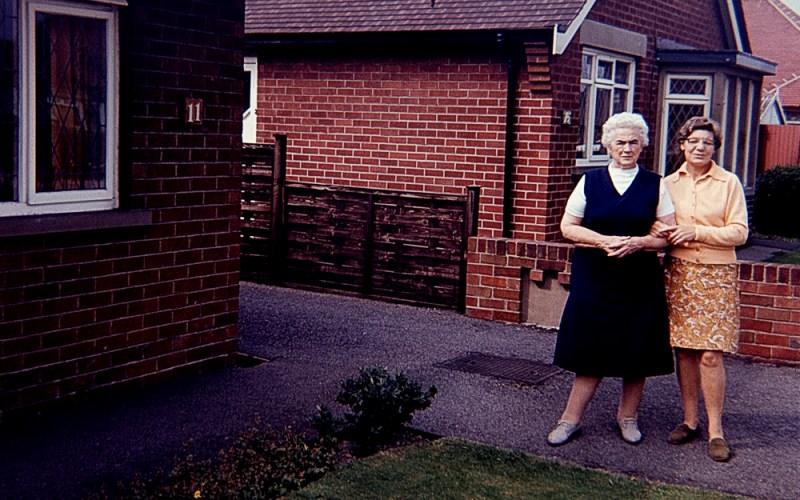 Two women in front garden