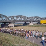 Crowd walking past multi-section steel bridge, Oct 1976