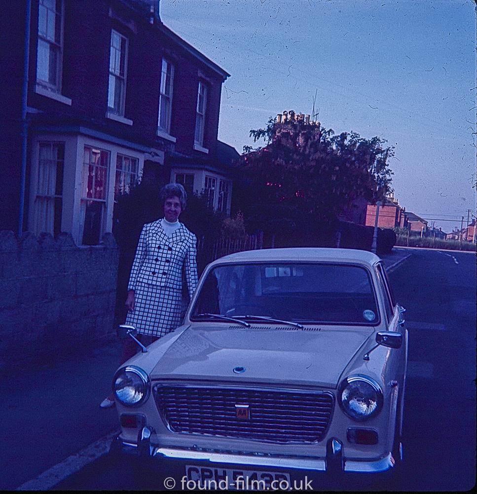 Woman with an Austin car c1967