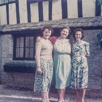 Family group outside their house in the 1950s