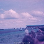 Multiple cars at 1950s Motor race