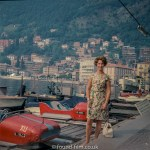 Woman standing by speed boats on Swiss Lake