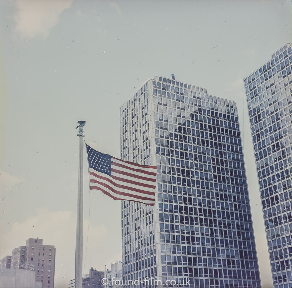 Skyscrapers and the American flag