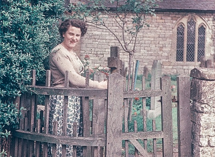 Woman standing by church gate