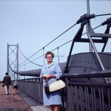 Woman standing my iron bridge