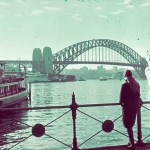 Views around Australia - Woman looking out at Sydney Harbour bridge