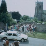 A photo of a wedding group at the entrance the the church yard
