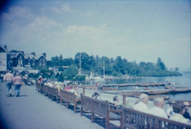 A colour slide showing seats by the edge of a lake.
