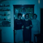 A poorly lit colour slide of a group in doors