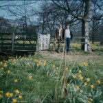 A slightly out of focus portrait of two men in a field