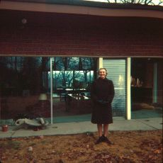 Portrait by a building from the 1960s