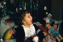 A small child at Christmas in the late 1950s