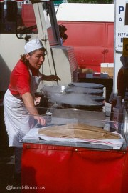 A Woman making Pizza?