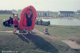 Two small boys playing with a dingy