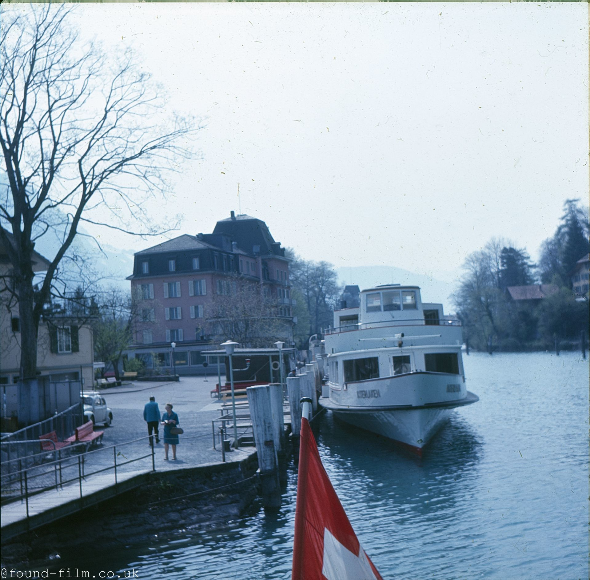 A Motor cruiser moored by the side of a river or canal
