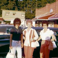 Three ladies by a car from 1973