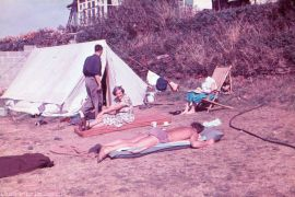 Colourful photo of a family camping in the 1950s