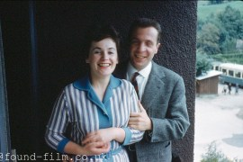 Portrait of a couple standing by a wall, 1959