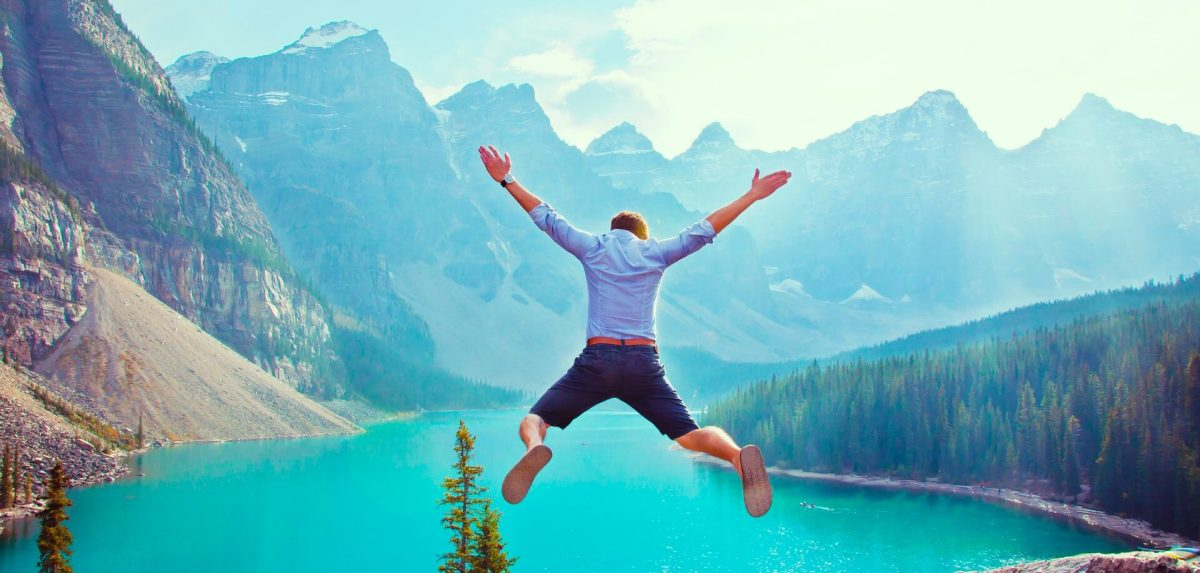 Man jumping on a cliff