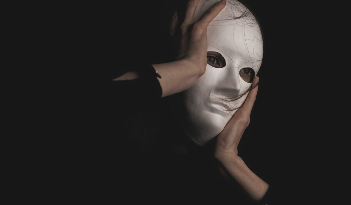 Person in a white mask