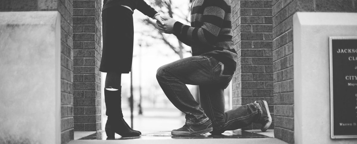 man on knees before woman