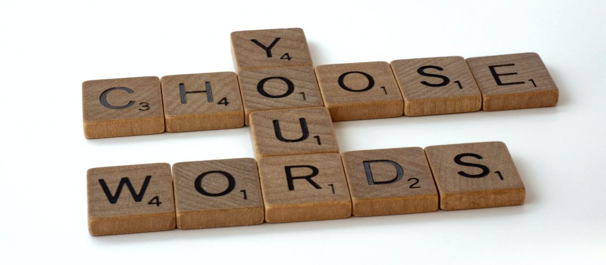 Scrabble letter tiles spelling out Choose Your Words