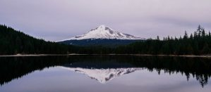 A mountain landscape reflected in the water