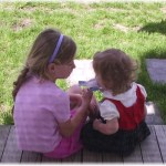 Sisters sharing a popsicle