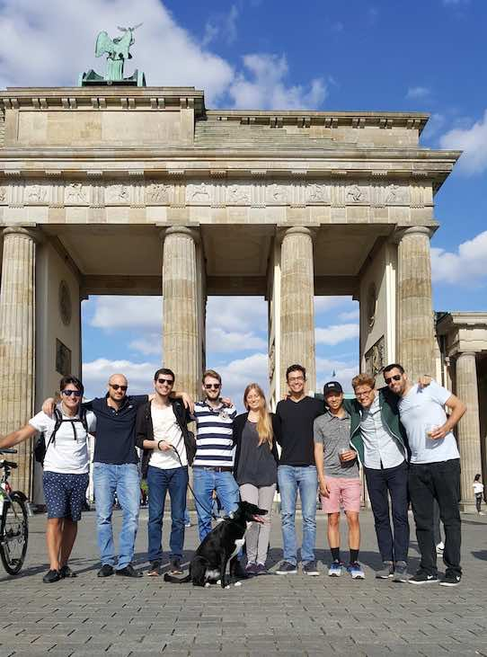 The Berlin employees of Machinio in front of the Brandenburg gate in Germany. Photo: Machinio