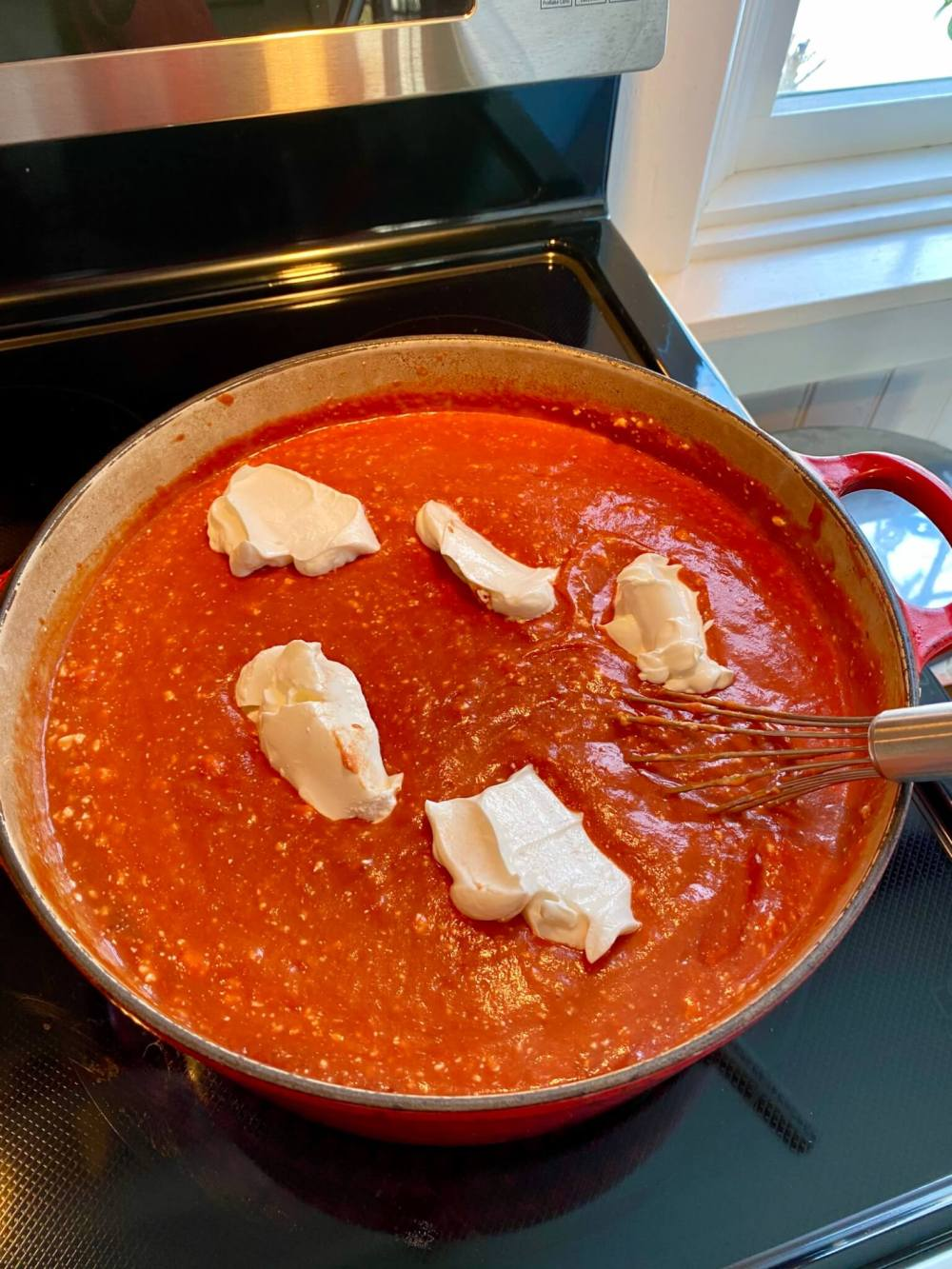 """Those familiar with Isaac's restaurants have likely heard of their signature soup, which has legions of devoted fans. The popular menu item is described as a """"creamy tomato soup given a zippy twist with shredded pepperjack cheese, garnished with croutons."""" The following copycat version adds an extra kick with hot sauce, although you could omit it if preferred."""
