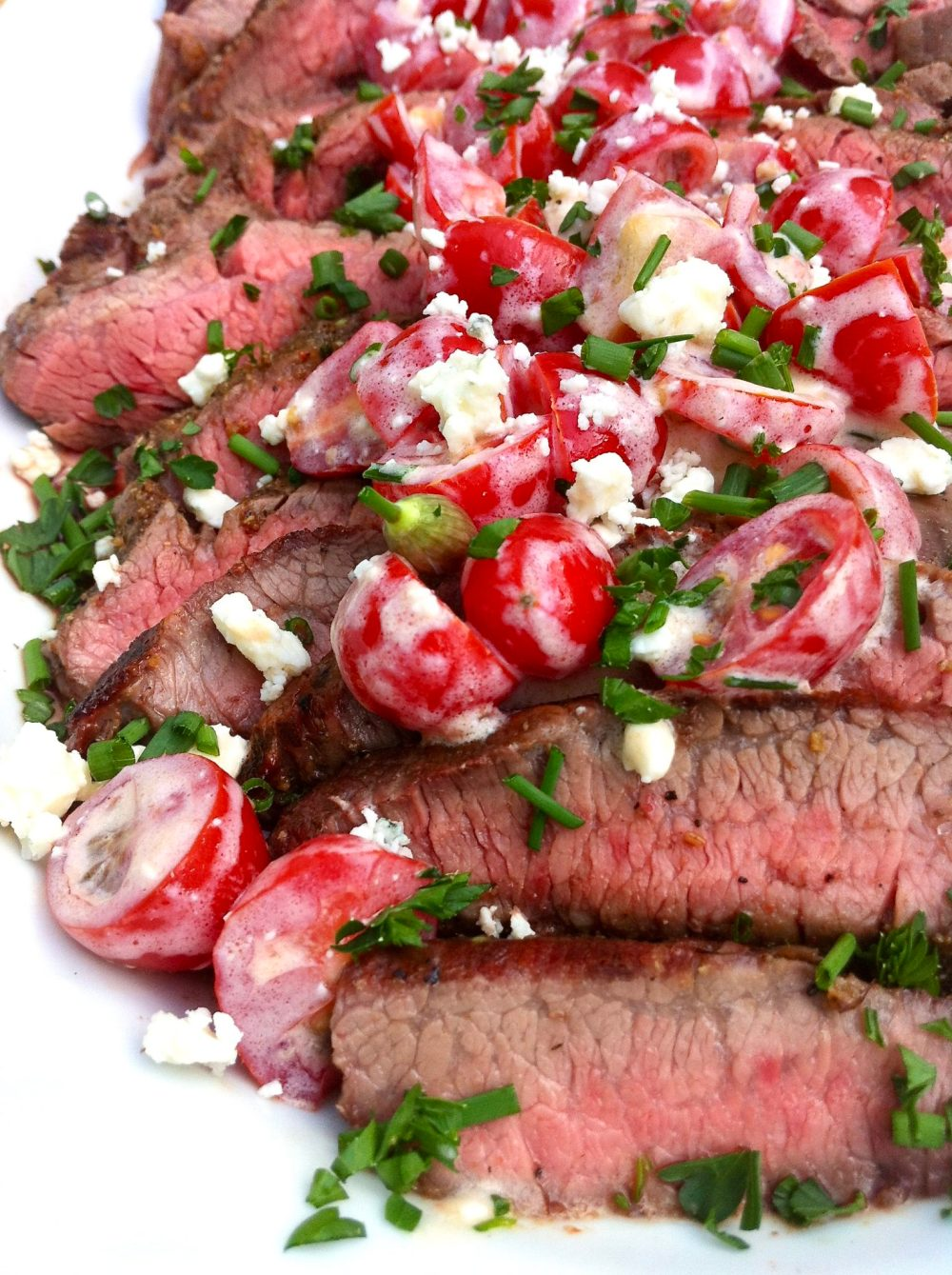 A healthy topping adds complementary flavor and fresh appeal to grilled flank steak. It's easy to make and leftovers offer an ideal protein topper to a big dinner salad another night.