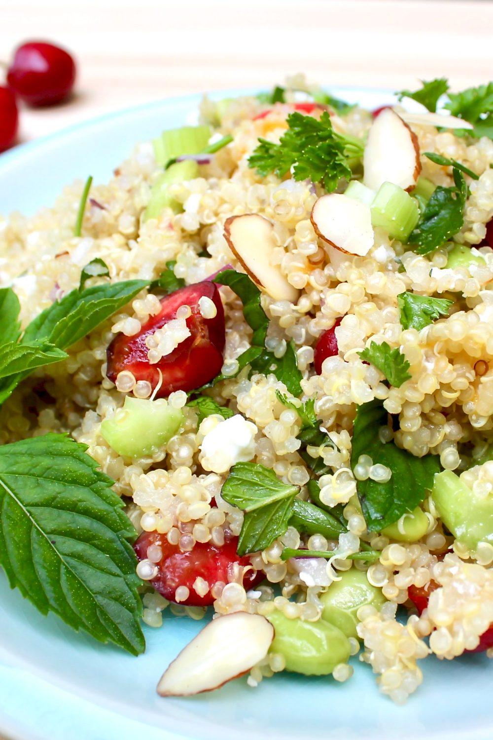 Sweet Cherry & Feta Quinoa with Peach Vinaigrette-a light, flavor-packed salad that's delightful paired with virtually any grilled protein but stands alone as a complete vegetarian meal