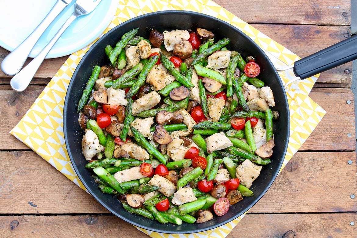 One-Pan Pesto Chicken and Veggies provides filling protein and a hearty serving of colorful vegetables for a speedy, flavor-packed weeknight meal!