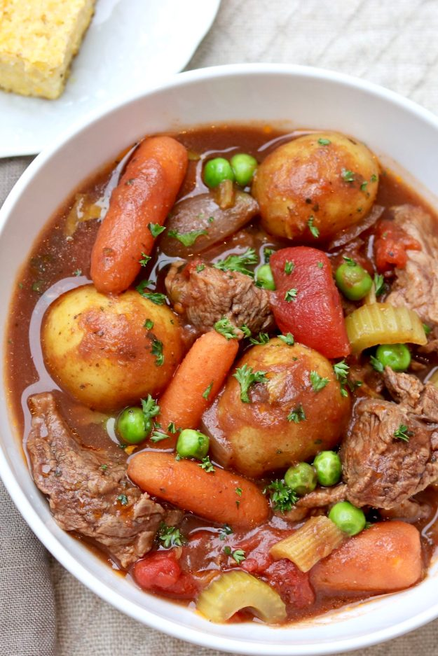Slow Cooker Beef Stew (with Instant Pot option) — Inspired by the tomatoey beef stew that my mom and grandmother used to make, this comforting dish is loaded with tender meat and wholesome vegetables and comes together in snap. I loved this as a child—and still do!