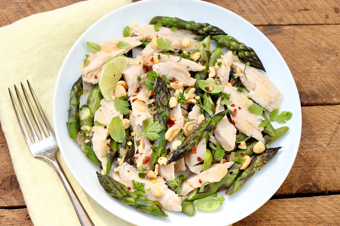 Asparagus & Chicken Salad With Sesame Ginger Dressing-A light yet filling spin on the usual chicken salad includes a hearty dose of vegetables and a versatile vinaigrette instead of mayo. Elegant and easy with prep-ahead options.