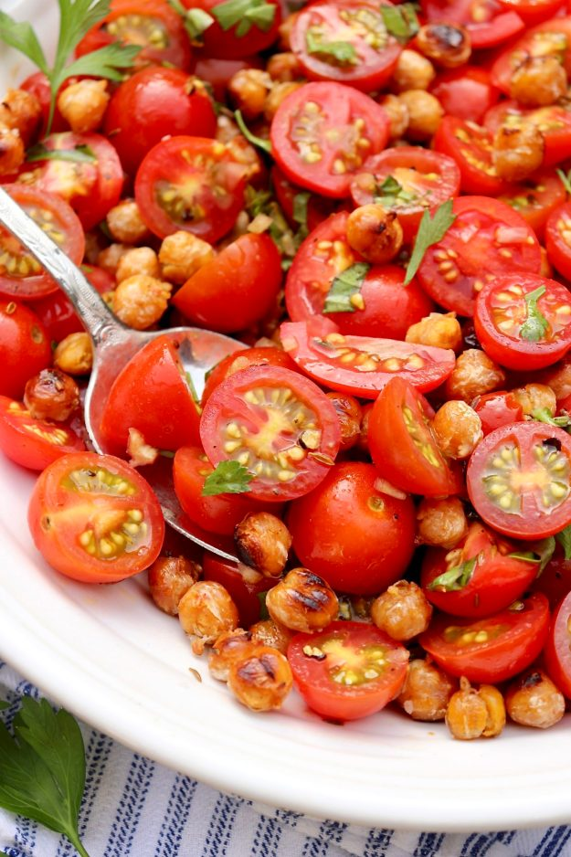 TOMATO & SEARED GARBANZO SALAD-Garden fresh tomatoes meet the humble can of beans in this healthy, protein-rich salad. A few additional pantry items supply unparalleled flavor.