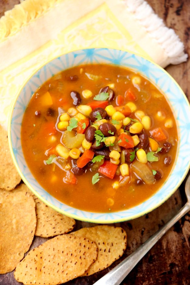PUMPKIN AND BLACK BEAN SOUP - a super-healthy, stick-to-your-ribs, vegan soup that's easy to customize. The big-batch recipe only gets better with age, making leftovers a real treat!