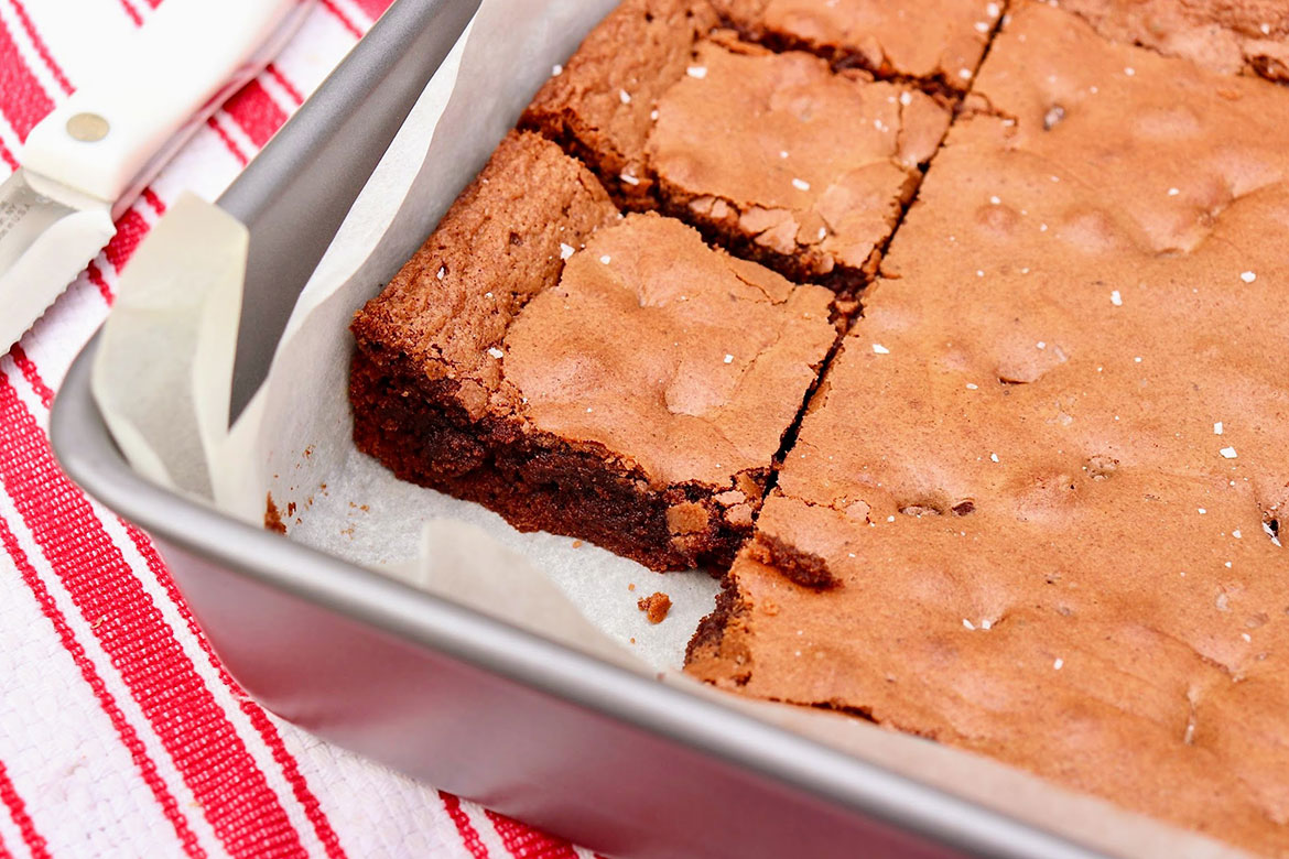 "Chewy edges yield to delightfully creamy insides and a ""just right"" chocolate flavor in these Nutella-infused brownies...and the recipe fills a 9x13 pan!"