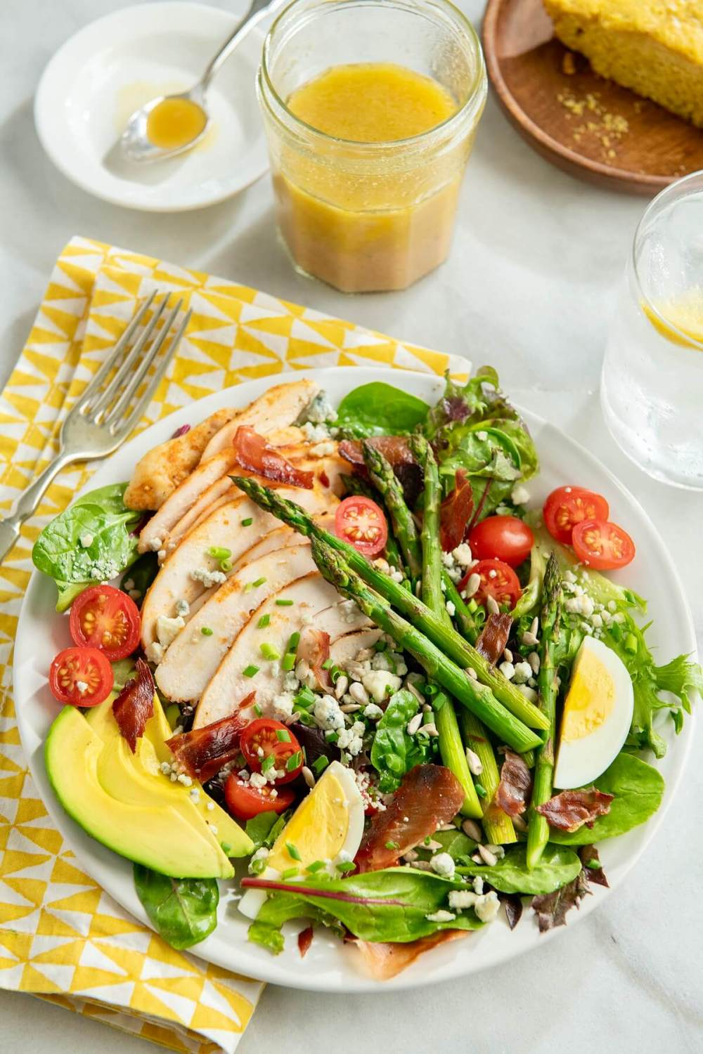 Sure, you can make a regular Cobb salad, and it will taste great. But adding asparagus ramps up the color, nutritional value, and seasonal appeal. If you don't usually have salads for dinner, this satisfying plateful might win you over. (Bonus recipes included!)