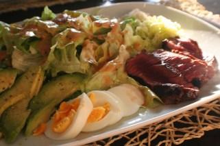 Salad creation with avocado, egg & beef