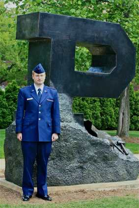 "2nd Lt., Standing next to the ""Emerging P"" statue on campus"